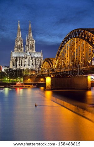 Cologne, Germany. Image of Cologne with Cologne Cathedral and Hohenzollern bridge across the Rhine River. - stock photo