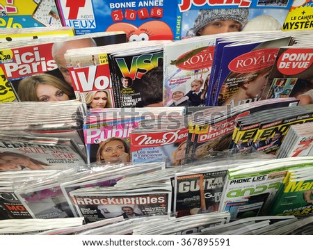 Cologne,Germany- January 26,2016: Popular german magazines on display in a store in Cologne,Germany  - stock photo