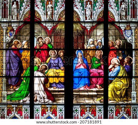 COLOGNE, GERMANY - JULY 21: Stained glass church window with Pentecost theme in the cathedral on July 21, 2014 in Cologne  - stock photo
