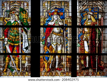 COLOGNE, GERMANY - JULY 21:The Nativity of Christ, stained glass church window, the detail with St. Gereon, St. Maurice and St. George  in the Dom on July 21, 2014 in Cologne  - stock photo