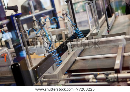 COLOGNE, GERMANY - MARCH 27 : New C-400 case erector on display at the Lantech booth at the ANUGA FoodTec industry trade show in Cologne, Germany on March 27, 2012. - stock photo