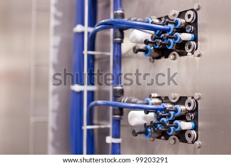 COLOGNE, GERMANY - MARCH 27 : New Contiflow continuous mixer on display at the Krones booth at the ANUGA FoodTec industry trade show in Cologne, Germany on March 27, 2012. - stock photo