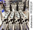 COLOGNE, GERMANY - MARCH 27 : New Prasmatic TSC310 case packer on display at the Aetna Group booth at the ANUGA FoodTec industry trade show in Cologne, Germany on March 27, 2012. - stock photo
