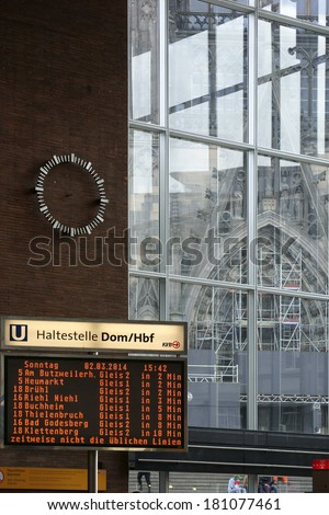 COLOGNE, GERMANY - MARCH 2: The digital display of the Cologne main train station with the cathedral in the background on March 02, 2014 in Cologne / Cologne Central Station