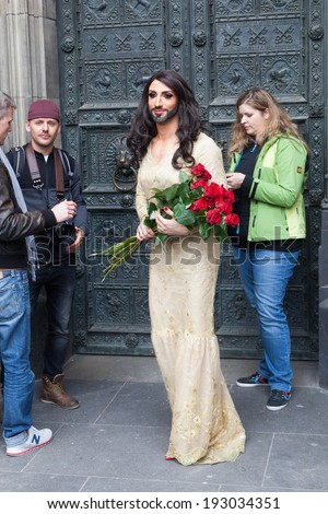 COLOGNE, GERMANY - MAY 15: Conchita Wurst at the Cologne Cathedral with other unidentified people on May 15, 2014 in Cologne. Conchita Wurst is the this years Eurovision Song Contest winner - stock photo