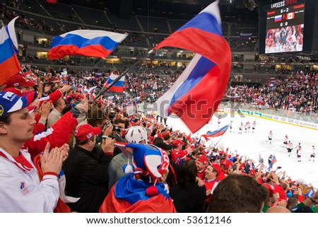 COLOGNE, GERMANY - MAY 20 : 2010 Ice Hockey World Championship. Spectators on the quarterfinal game between Russia and Canada. Russia win 5:2. April 20, 2010 in Cologne, Germany - stock photo