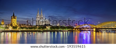 Cologne, Germany. Panoramic image of Cologne with Cologne Cathedral during twilight blue hour. - stock photo