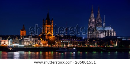 Cologne, Germany. Panoramic view of city center with Cathedral, Great St. Martin Church and other historical buildings, various restaurants, cafes and bars