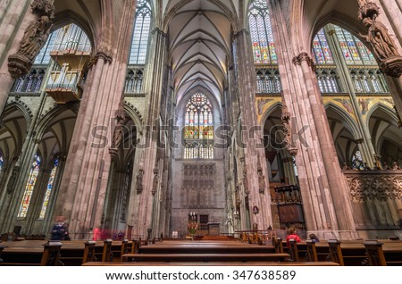 COLOGNE, GERMANY - SEPTEMBER 17, 2015: Interior of the Cologne Cathedral. Roman Catholic cathedral in gothic style. Nave, ceiling, organ, columns and stained glass. World Heritage Site. - stock photo