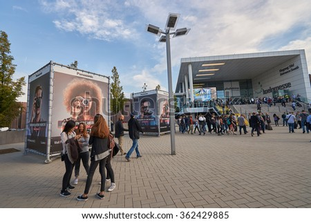 COLOGNE, GERMANY - SEPTEMBER 19, 2014: South Entrance of the Cologne Trade Fair during Photokina. The Photokina is the world's largest trade fair for the photographic and imaging industries - stock photo