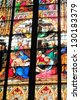 COLOGNE, GERMANY-SEPTEMBER 25- The stained glass of Cologne Cathedral on September 25, 2010 fills the church with light and images of the crucifixion of Christ. - stock photo