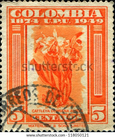 COLOMBIA - CIRCA 1949: A stamp printed in Colombia shows Cattleya Dowiana Aurea, circa 1949 - stock photo