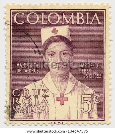 COLOMBIA - CIRCA 1961: A stamp printed in Colombia, shows portrait of Manuelita de la Cruz, Issued in memory of Red Cross Nurse, circa 1961 - stock photo