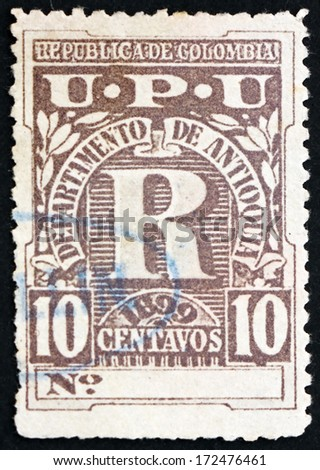 COLOMBIA - CIRCA 1899: a stamp printed in the Colombia, Antioquia, shows Letter R, Registration Stamp, circa 1899 - stock photo