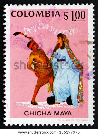 COLOMBIA - CIRCA 1971: a stamp printed in the Colombia shows Dancers and Music, Currulao, Chicha Maya Dancers and Music, circa 1971 - stock photo