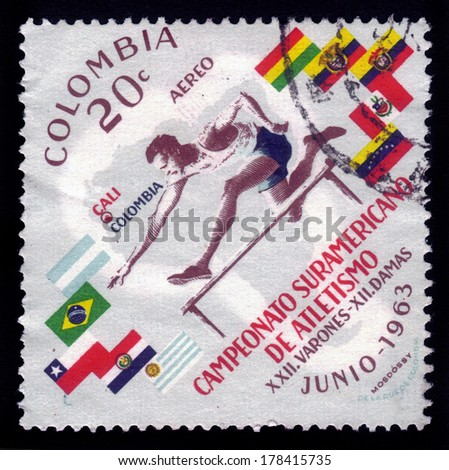 COLOMBIA - CIRCA 1963: a stamp printed in the Colombia shows running hurdles, american athletics championship in Gali, circa 1963 - stock photo