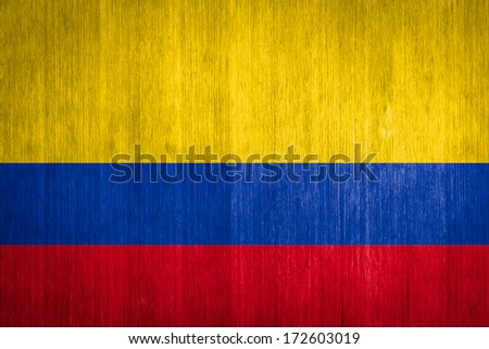 Colombia Flag on wood background - stock photo