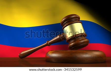 Colombia law, legal system and justice concept with a 3d render of a gavel on a wooden desktop and the Colombian flag on background. - stock photo