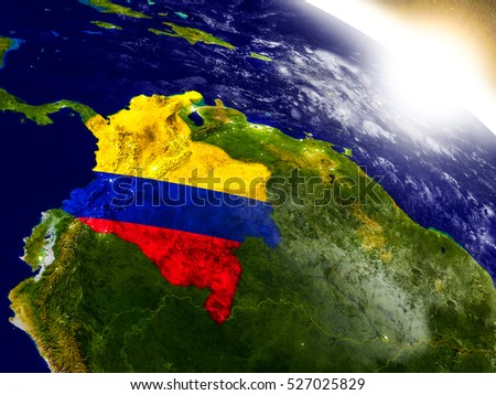 Colombia with embedded flag on planet surface during sunrise. 3D illustration with highly detailed realistic planet surface and visible city lights. Elements of this image furnished by NASA.