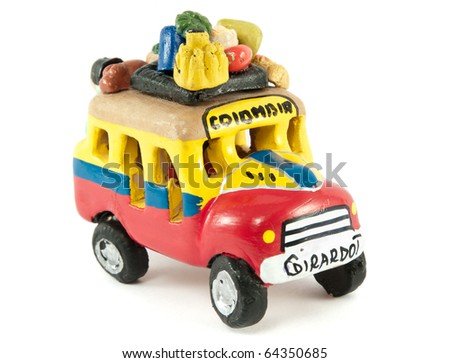 Colombian bus or Chiva in the colors of the flag of Colombia - stock photo