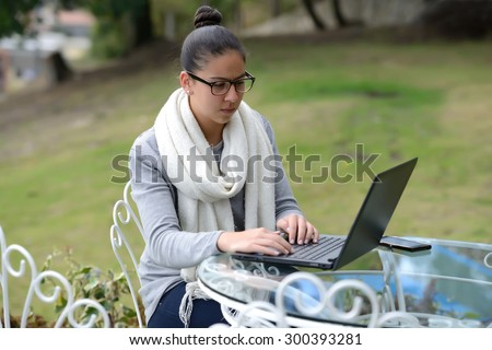 Colombian Business Woman working outdoor - stock photo
