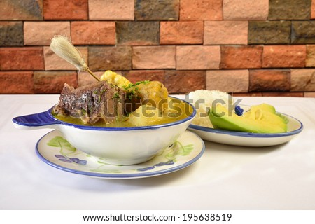 Colombian cuisine. Caldo de costilla. - stock photo