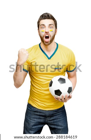 Colombian fan holding a soccer ball celebrates on white background - stock photo
