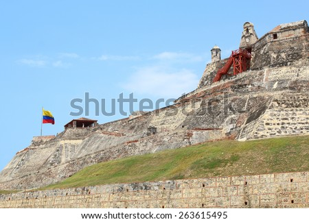 Colombian flag over the walls of the fortress of Castillo San Felipe in Cartagena, Colombia. - stock photo