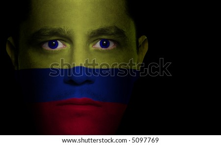 Colombian flag painted/projected onto a man's face.