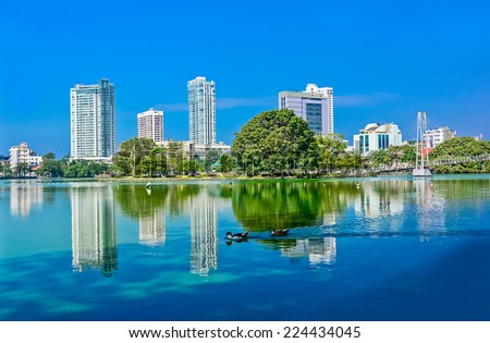 Colombo Beira Lake And Skyline, A Lake In The Heart Of The City Of Colombo That Surrounded By Many Large Businesses In The City - stock photo