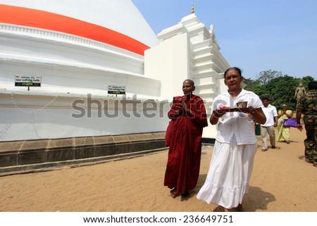 COLOMBO,  SRI LANKA - DEC 11: Unidentified Buddhist  monks do prayers around the Kelaniya Raja Maha Vihara on December 11, 2013 in Colombo, Sri Lanka.  - stock photo