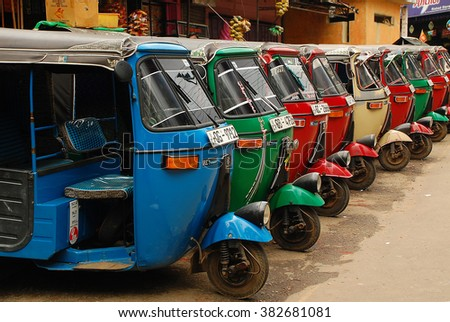 COLOMBO, SRI LANKA - DECEMBER 5, 2008:Three-weelers at the tuk-tuk stand in the capital of the country - stock photo