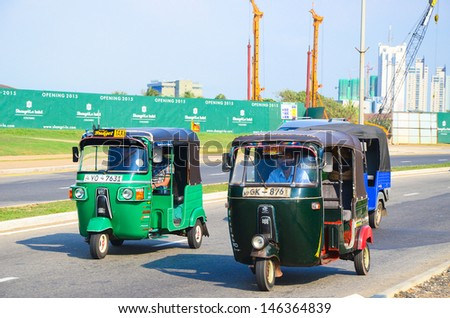 COLOMBO, SRI LANKA - MARCH. 16: Sri Lankan traditional taxi on March 16, 2013 in Colombo. Colombo is the largest city and former capital of Sri Lanka with population about 1 million people. - stock photo