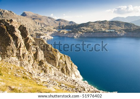 Colomina Lake in Aiguestortes Park, Spain, sunny atumn day. - stock photo
