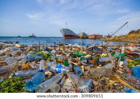 COLON, PANAMA - APRIL 15, 2015: Enviromental Pollution washing ashore next to the Panama Canal in the beach - stock photo