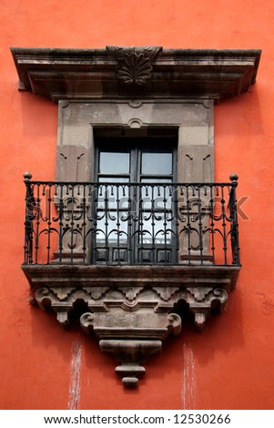 Colonial balcony. View on a typical urban scene with closed French window. San Miguel de Allende, Mexico