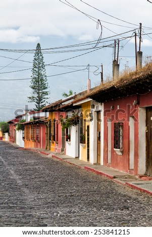 Colonial buildings and cobbled streets in Antigua, Guatemala, Central America - stock photo