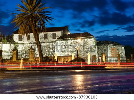 Colonial castle in Old Havana at sunset with light trails from passing cars - stock photo