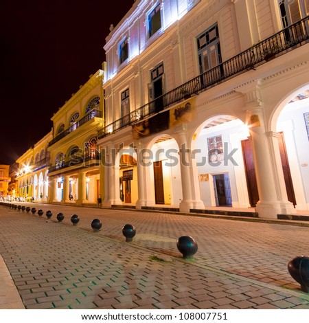 Colonial houses illuminated at night on the famous  Plaza Vieja square in Old Havana - stock photo