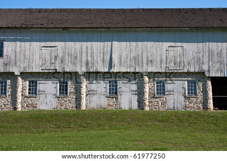 Colonial stone and wood horse stables - stock photo