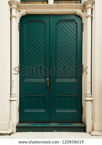 Colonial style Colonial Green Door on white house - stock photo