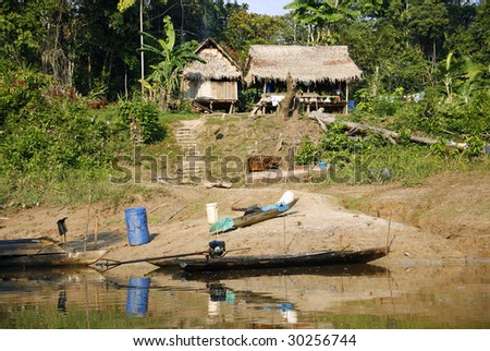 Colonist house beside the rio Manati near Iquitos, Peru - stock photo