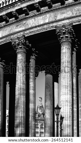 Colonnade of the Kazan Cathedral and Singer house between columns (black and white processing) - stock photo