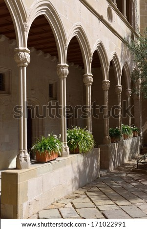 Colonnade with fresh flowers