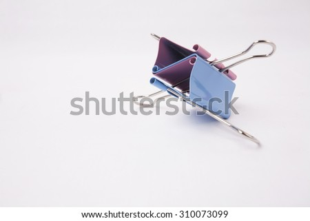Color binder clips isolated on white background