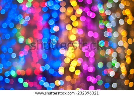Color Bokeh against a dark background for use at graphic design  - stock photo