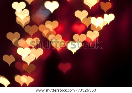 Color Bokeh on a dark background with hearts for use in graphic design - stock photo
