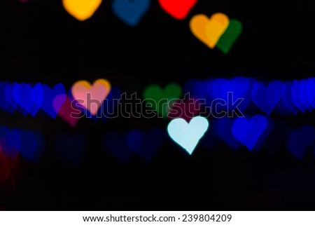 Color Bokeh on a dark background with hearts use for graphic design - stock photo