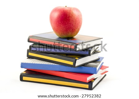Color books and red apple isolated on white background