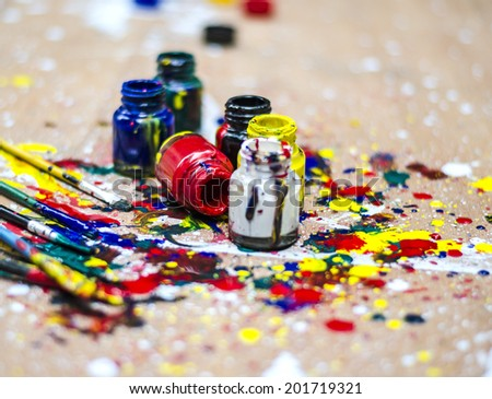 Color bottle and dirty splash on artwork desk - stock photo